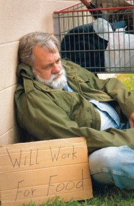 Homeless man w sign-sm file
